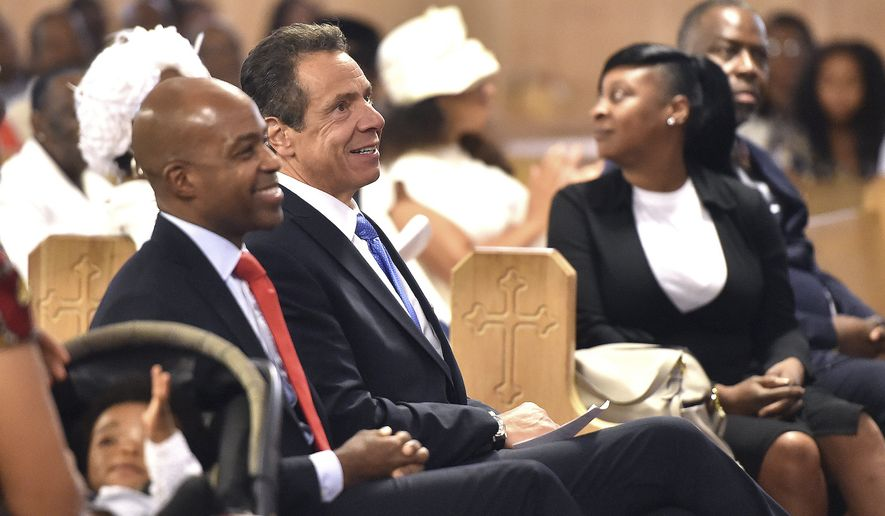 "In this photo provided by the Office of the Governor of New York, New York Gov. Andrew Cuomo, center left, sits with the congregation at the First Baptist Church of Crown Heights in the Brooklyn borough of New York, Sunday, Aug. 19, 2018. In a searing speech from the pulpit, Cuomo said Donald Trump has fooled many people in this country, but the Democrat said the Republican president hasn't fooled New Yorkers. Cuomo hammered the president for creating what he called a ""frightening portrait"" of today's America. (Office of the Governor of New York/Kevin Coughlin via AP)"