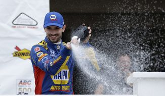 Alexander Rossi celebrates in Victory Lane after winning the IndyCar auto race at Pocono Raceway, Sunday, Aug. 19, 2018, in Long Pond, Pa. (AP Photo/Matt Slocum)