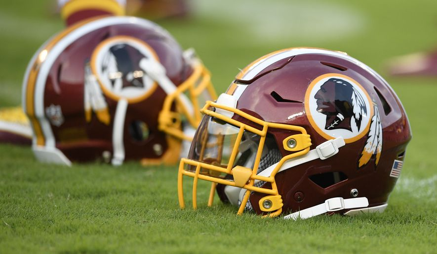 A Washington Redskins football helmet lies on the field before a preseason NFL football game against the New York Jets, Thursday, Aug. 16, 2018, in Landover, Md. (AP Photo/Nick Wass) ** FILE **