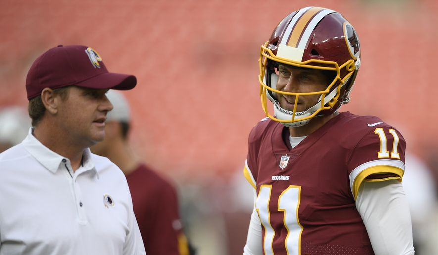 Washington Redskins quarterback Alex Smith (11) stands next to Washington Redskins head coach Jay Gruden, left, before a preseason NFL football game against the New York Jets, Thursday, Aug. 16, 2018, in Landover, Md. (AP Photo/Nick Wass) **FILE**
