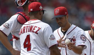 Washington Nationals starting pitcher Gio Gonzalez, right, is pulled from the game by manager Dave Martinez during the fifth inning of a baseball game against the Miami Marlins, Sunday, Aug. 19, 2018, in Washington. (AP Photo/Nick Wass)