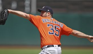 Houston Astros pitcher Justin Verlander works against the Oakland Athletics in the first inning of a baseball game Sunday, Aug. 19, 2018, in Oakland, Calif. (AP Photo/Ben Margot)