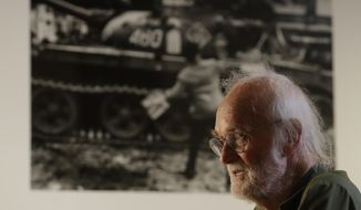 "In this Aug. 10, 2018 photo Josef Koudelka answers questions in a rare media interview with the Associated Press, at his retrospective exhibition ""Returning"" at the Museum of Decorative Arts in Prague, Czech Republic.  Powerful images taken by Koudelka some 50-years ago still resonate across the world by bringing back memories of the 1968 Soviet-led invasion of Czechoslovakia. (AP Photo/Petr David Josek)"