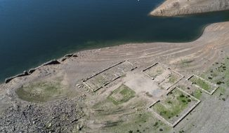 File - In this Thursday, Aug. 16, 2018 file photo the foundation walls of old buildings appear at the riverside of the Edersee in Waldeck, Germany  due to a low water level because of a drought period. (Swen Pfoertner/dpa via AP, file)