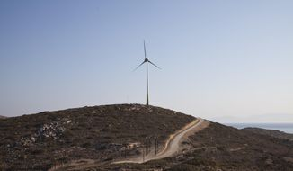 In this Thursday, Aug. 9, 2018 photo is seen a wind turbine on the Aegean island of Tilos, Greece.  When the blades of the 800 kilowatt wind turbine start turning, Tilos will become the first island in the Mediterranean to run exclusively on wind and solar power, feeding the needs of its population of some 400 people in winter, and some 3000 in summer.  (AP Photo/ Iliana Mier)