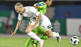 Vissel Kobe's Andres Iniesta, fornt, of Spain and Shonan Bellmare's Mitsuki Saito, back, fight for a ball during their J-League soccer match in Hiratsuka, south of Tokyo Sunday Aug. 19, 2018. (Tsuyoshi Ueda/Kyodo News via AP)