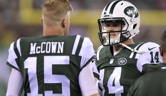 FILE - In this Friday, Aug. 10, 2018, file photo, New York Jets quarterback Sam Darnold (14) talks with quarterback Josh McCown (15) during the first half of a preseason NFL football game against the Atlanta Falcons, in East Rutherford, N.J. McCown is still No. 1 on the New York Jets' quarterbacks depth chart. At this point, though, he might as well be No. 100. (AP Photo/Bill Kostroun, File)