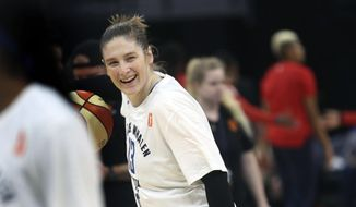 Minnesota Lynx's Lindsay Whalen laughs with teammates before a WNBA basketball game against the Washington Mystics in Minneapolis, Sunday, Aug. 19, 2018. (Kyndell Harkness/Star Tribune via AP)