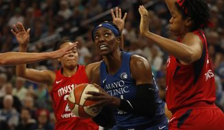 Minnesota Lynx's Sylvia Fowles, center, looks for an opening against the Washington Mystics during a WNBA basketball game in Minneapolis, Sunday, Aug. 19, 2018. (Richard Tsong-Taatarii/Star Tribune via AP)