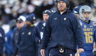 FILE- In this Dec. 28, 207, file photo, Navy head coach Ken Niumatalolo watches from the sideline in the first half of the Military Bowl NCAA college football game in Annapolis, Md. Navy is handing the keys to its triple-option offense to Malcolm Perry. Perry was the starting slotback for eight games last season before Niumatalolo switched him to quarterback to spark a struggling offense. (AP Photo/Gail Burton, File)