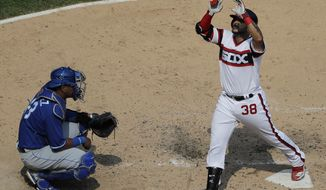 Chicago White Sox's Omar Narvaez, right, celebrates after hitting a solo home run as Kansas City Royals catcher Salvador Perez, top, looks to the field during the fourth inning of a baseball game, Sunday, Aug. 19, 2018, in Chicago. (AP Photo/Nam Y. Huh)
