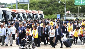 South Koreans leave for North Korea to take part in family reunions with their North Korean family members at the customs, immigration and quarantine (CIQ) office in Goseong, South Korea, Monday, Aug. 20, 2018. About 200 South Koreans and their family members prepared to cross into North Korea on Monday for heart-wrenching meetings with relatives most haven't seen since they were separated by the turmoil of the Korean War. (Korea Pool/Yonhap via AP)