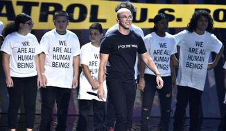 """Logic performs """"One Day"""" onstage at the MTV Video Music Awards at Radio City Music Hall on Monday, Aug. 20, 2018, in New York. (Photo by Chris Pizzello/Invision/AP)"""