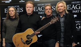 "From left, Timothy B. Schmit, Don Henley, Glenn Frey and Joe Walsh of The Eagles pose together with an autographed guitar after a news conference at the 2013 Sundance Film Festival, Saturday, Jan. 19, 2013, in Park City, Utah. The documentary film ""The History of The Eagles Part 1"" is being shown at the festival. (Photo by Chris Pizzello/Invision/AP)"