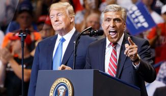 Republican Senate candidate Rep. Lou Barletta, R-Pa., speaks as President Donald Trump listens during a rally, Thursday, Aug. 2, 2018, at Mohegan Sun Arena at Casey Plaza in Wilkes Barre, Pa.. (AP Photo/Carolyn Kaster)