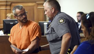 Christopher Watts glances back at a Weld County Sheriff's Deputy as he is escorted out of the courtroom at the Weld County Courthouse Thursday, Aug. 16, 2018, in Greeley, Colo. Watts, of Colorado, whose wife and daughters disappeared this week was arrested on suspicion of killing them. (Joshua Polson/The Greeley Tribune via AP, Pool)