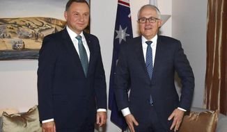 Australia's Prime Minister Malcolm Turnbull, right, meets with Poland's President Andrzej Duda at Parliament House in Canberra, Monday, Aug. 20, 2018. (Mick Tsikas/Pool Photo via AP)