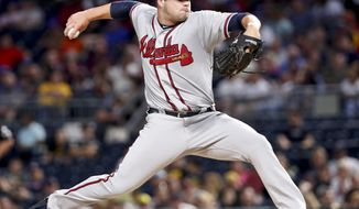 Atlanta Braves starter Bryse Wilson pitches against the Pittsburgh Pirates in the fifth inning of a baseball game, Monday, Aug. 20, 2018, in Pittsburgh. (AP Photo/Keith Srakocic)