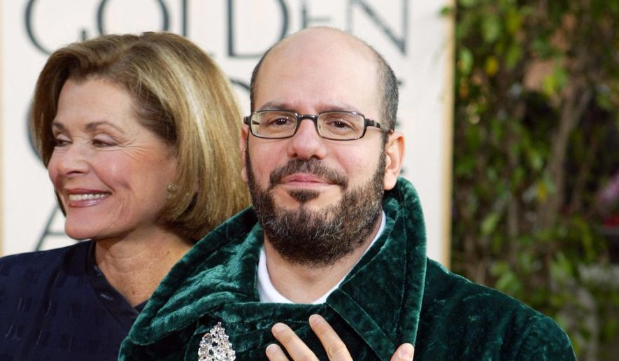 """In this Jan. 25, 2004, file photo comedian David Cross and actress Jessica Walter, of the television comedy """"arrested Development,"""" arrive for the 61st Annual Golden Globe Awards in Beverly Hills, Calif. The University of Utah says a tweet from comedian Cross showing him wearing undergarments sacred to the Mormon faith was """"deeply offensive."""" Still, President Ruth Watkins resisted online calls to cancel his upcoming performance on campus, saying in a statement Sunday, Aug. 19, 2018, the photo intended to promote the show is protected by the First Amendment. (AP Photo/Kevork Djansezian,File)"""
