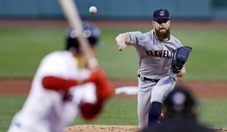 Cleveland Indians starting pitcher Corey Kluber delivers during the first inning of a baseball game against the Boston Red Sox at Fenway Park in Boston, Monday, Aug. 20, 2018. (AP Photo/Charles Krupa)
