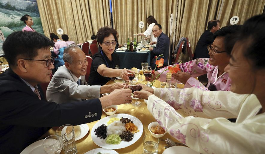 South Korean Cho Kwon-hyung, 80, second from left, toasts with his North Korean family members during a dinner at the Diamond Mountain resort in North Korea, Monday, Aug. 20, 2018. Dozens of elderly South Koreans crossed the heavily fortified border into North Korea for heart-wrenching meetings with relatives most haven't seen since they were separated by the turmoil of the Korean War. (Lee Ji-eun/Yonhap via AP) ** FILE **