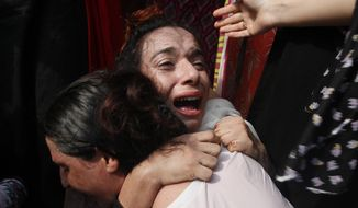 A Pakistani transgender woman mourns the death of her colleague, during a protest in Peshawar, Pakistan, Monday, Aug. 20, 2018. A transgender person was shot dead on Thursday night, police said. (AP Photo/Muhammad Sajjad)