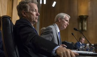 Sen. Rand Paul, R-Ky., left, and Sen. Rob Portman, R-Ohio, pose questions to witnesses as the Senate Committee on Foreign Relations holds a hearing on relations between the U.S. and Russia, on Capitol Hill in Washington, Tuesday, Aug. 21, 2018. (AP Photo/J. Scott Applewhite)