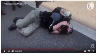 """Paul Welch, 38, clutches the back of his head after being beaten on the back of the head by a member of Antifa, Aug. 4, 2018. He told The Oregonian for an interview published Aug. 20 that his bones """"turned to Jell-O after the attack."""" (Image: YouTube, the Oregonian screenshot)"""