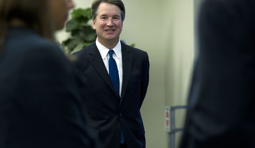 Supreme Court nominee Judge Brett Kavanaugh walks to meet with Sen. Amy Klobuchar, D-Minn., on Capitol Hill in Washington, Tuesday, Aug. 21, 2018. (AP Photo/Jose Luis Magana)