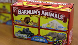 """This Monday, Aug. 20, 2018, photo shows boxes of Nabisco's Barnum's Animals crackers in Chicago. After more than a century behind bars, the beasts on boxes of animal crackers are roaming free. The new boxes retain their familiar red and yellow coloring and prominent """"Barnum's Animals"""" lettering. But instead of showing the animals in cages, implying that they're traveling in boxcars for the circus, the new boxes feature a zebra, elephant, lion, giraffe and gorilla wandering side-by-side in a grassland. (AP Photo/Kiichiro Sato)"""