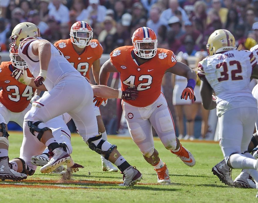 FILE - In this Sept. 23, 2017, file photo, Clemson's Christian Wilkins (42) defends during the first half of an NCAA college football game against Boston College, in Clemson, S.C. Wilkins was selected to the AP Preseason All-America team, Tuesday, Aug. 21, 2018. (AP Photo/Richard Shiro, File)