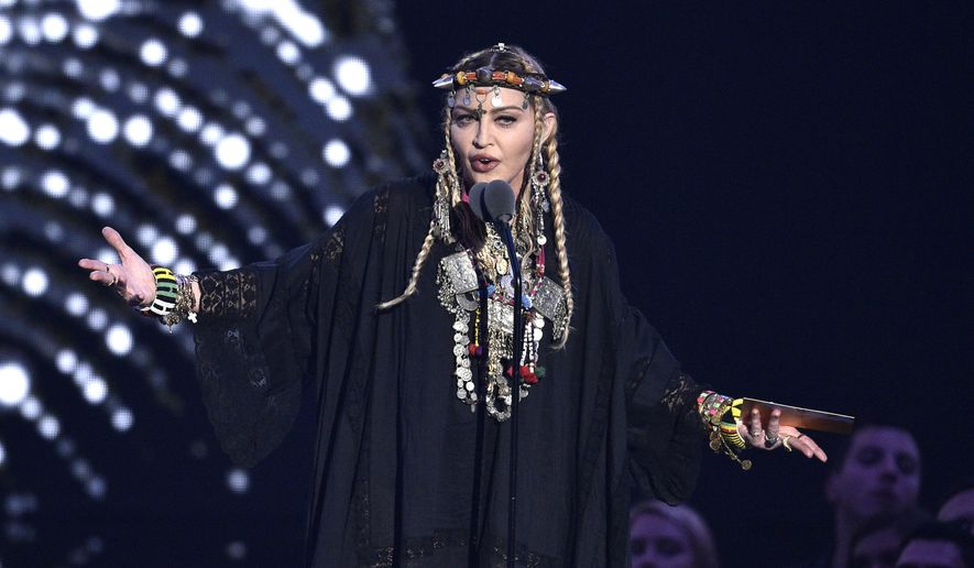 Madonna presents a tribute to Aretha Franklin at the MTV Video Music Awards at Radio City Music Hall on Monday, Aug. 20, 2018, in New York. (Photo by Chris Pizzello/Invision/AP) ** FILE **