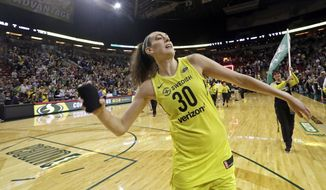 FILE - In this Aug. 17, 2018, file photo, Seattle Storm's Breanna Stewart tosses a T-shirt to fans after the Storm's 85-77 win over the New York Liberty in a WNBA basketball game, in Seattle. Stewart has taken her game to a new level this year to lead Seattle to the top spot in the league.  Her efforts earned her Associated Press WNBA Player of the Year honors on Tuesday, Aug. 21, 2018. (AP Photo/Elaine Thompson, File)