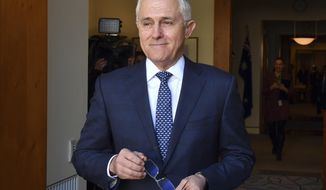 FILE - In this Aug. 20, 2018, file photo, Australia's Prime Minister Malcolm Turnbull arrives for a meeting with Poland's President Andrzej Duda at Parliament House in Canberra. Prime Minister Turnbull has long been under attack from the most conservative element of his party who have always regarded him as too progress to lead an Australian center-right government. The 63-year-old former journalist, lawyer and merchant banker has a history of championing progressive causes including gay marriage, making polluters pay for greenhouse gas emissions and severing constitutional ties with Britain by making Australia a republic. (Mick Tsikas/Pool Photo via AP, File)