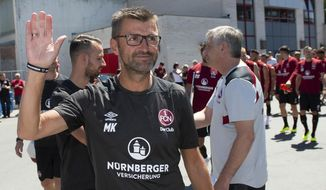 FILE - In this Tuesday, July 3, 2018 photo Michael Koellner, head coach of the German first division, Bundesliga, team 1. FC Nuremberg attends the new season's first training session in Nuremberg, Germany. (Timm Schamberger/dpa via AP, file)