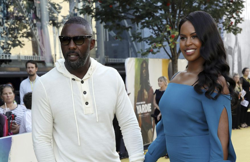 Director Idris Elba, left, and partner Sabrina Dhowre pose for photographers on arrival at the premiere of the film 'Yardie', in London, Tuesday, Aug. 21, 2018. (Photo by Grant Pollard/Invision/AP)