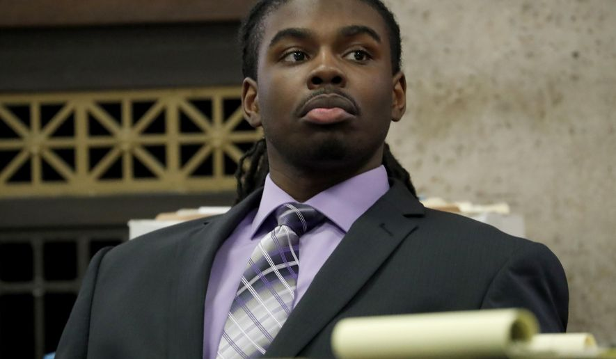 Defendant Micheail Ward listens during the trial for the fatal shooting of Hadiya Pendleton at the Leighton Criminal Court Building in Chicago on Tuesday, Aug. 21, 2018. Prosecutors played a videotape for jurors Tuesday, of an interrogation of a man who ultimately confessed to pulling the trigger in the fatal 2013 shooting of a 15-year-old Chicago honor student Hadiya Pendleton. On the video, Ward can be heard telling police how he fired into a park, aiming for who he believed were rival gang members. Ward is charged with first-degree murder, as is the alleged getaway driver, Kenneth Williams. (Jose M. Osorio/Chicago Tribune via AP, Pool)