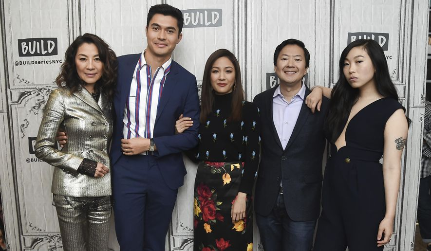 """In this Aug. 14, 2018, file photo, actors Michelle Yeoh, from left, Henry Golding, Constance Wu, Ken Jeong and Awkwafina participate in the BUILD Speaker Series to discuss the film """"Crazy Rich Asians"""" at AOL Studios in New York. (Photo by Evan Agostini/Invision/AP, File)"""