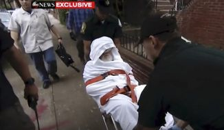In this Monday, Aug. 20, 2018, frame from video, Jakiw Palij, a former Nazi concentration camp guard, is carried on a stretcher from his home in the Queens borough of New York. Palij, the last Nazi war crimes suspect facing deportation from the U.S. was taken from his home and spirited early Tuesday morning to Germany, the White House said. (ABC via AP)
