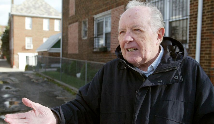 In this Nov. 20, 2003, file photo, Jakiw Palij, a former Nazi concentration camp guard, stands in front of a building in the Queens borough of New York. The White House says that Palij, a 95-year-old former Nazi concentration camp guard has been deported to Germany, 14 years after a judge ordered his expulsion. In a statement, the White House said the deportation of Palij, who lived in New York City, was carried out early Tuesday Aug. 21, 2018. (Suzanne DeChillo/The New York Times via AP, File)