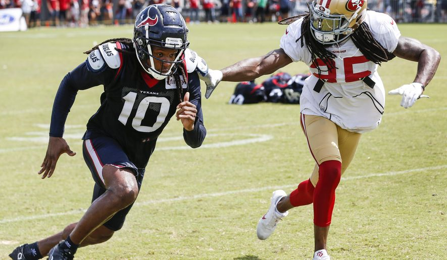 FILE - In this Aug. 16, 2018, file photo, Houston Texans wide receiver DeAndre Hopkins (10) and San Francisco 49ers defensive back Richard Sherman (25) run extra drills after a joint NFL football practice in Houston.  Sherman said Wednesday, Aug. 22, that he plans to play San Francisco's exhibition game at Indianapolis on Saturday in his first action for the 49ers at cornerback after spending his first seven seasons playing for NFC West rival Seattle. (Brett Coomer/Houston Chronicle via AP, File)