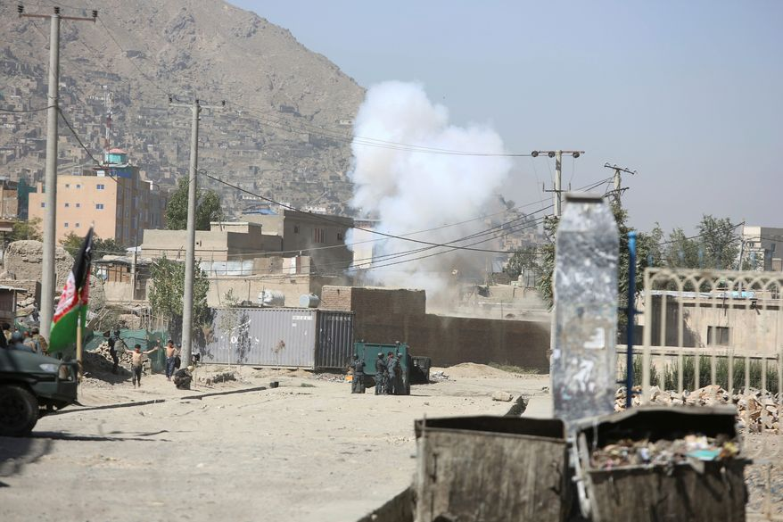 Smoke rises from a house where attackers are hiding in Kabul, Afghanistan, Tuesday, Aug. 21, 2018. The Taliban fired rockets toward the presidential palace in Kabul Tuesday as President Ashraf Ghani was giving his holiday message for the Muslim celebrations of Eid al-Adha, said police official Jan Agha. (AP Photo/Rahmat Gul) **FILE**