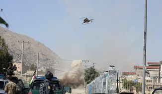 An MD 530F military helicopter targets a house where suspected attackers were hiding in Kabul, Afghanistan. Gen. John Nicholson said President Trump's reset of the U.S. military mission in Afghanistan is beginning to bear fruit. (ASSOCIATED PRESS)