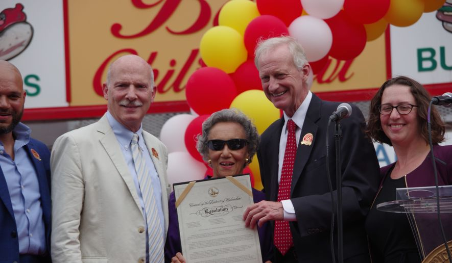 """D.C. Council Chairman Phil Mendelson (left), councilmember Jack Evans and councilmember Brianne Nadeau presented Ben's Chili Bowl co-founder Virginia Ali with a ceremonial resolution declaring Aug. 22 as """"Ben's Chili Bowl Day"""" in the District. (Julia Airey/THE WASHINGTON TIMES)"""