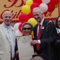"D.C. Council Chairman Phil Mendelson (left), councilmember Jack Evans and councilmember Brianne Nadeau presented Ben's Chili Bowl co-founder Virginia Ali with a ceremonial resolution declaring Aug. 22 as ""Ben's Chili Bowl Day"" in the District. (Julia Airey/THE WASHINGTON TIMES)"