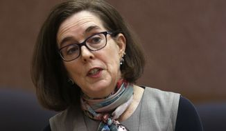 Oregon Gov. Kate Brown speaks to media representatives in Salem, Ore., Thursday, Jan. 26, 2017. Oregon legislative leaders are meeting at the Capitol in a forum with state media representatives to outline agendas for the upcoming legislative session in February. (AP Photo/Don Ryan)