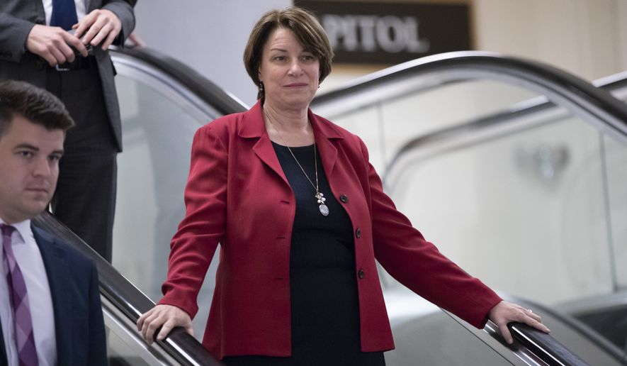 Sen. Amy Klobuchar, D-Minn., and other members of the Senate head to a closed-door briefing to update lawmakers on cyberattacks on the U.S. election system, at the Capitol in Washington, Wednesday, Aug. 22, 2018. (AP Photo/J. Scott Applewhite) ** FILE **