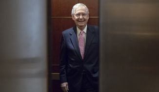 Senate Majority Leader Mitch McConnell, R-Ky., boards an elevator as he and other members of the Senate head to a closed-door briefing by FBI director Christopher Wray and Homeland Security Secretary Kirstjen Neilsen to update lawmakers on cyber attacks on the U.S. election system, at the Capitol in Washington, Wednesday, Aug. 22, 2018.  (AP Photo/J. Scott Applewhite)