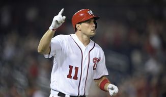 Washington Nationals' Ryan Zimmerman gestures after he hit a walk-off two-run home run during the team's baseball game against the Philadelphia Phillies, Wednesday, Aug. 22, 2018, in Washington. The Nationals won 8-7. (AP Photo/Nick Wass)