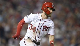 Washington Nationals' Bryce Harper runs toward first with a single during the fourth inning of the team's baseball game against the Philadelphia Phillies, Wednesday, Aug. 22, 2018, in Washington. (AP Photo/Nick Wass) **FILE**